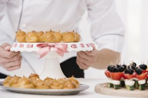 chef-holding-plate-with-flamed-meringue_23-2148245054