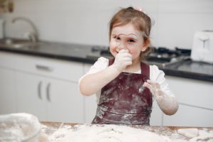little-girl-cook-dough-cookies_1157-21337